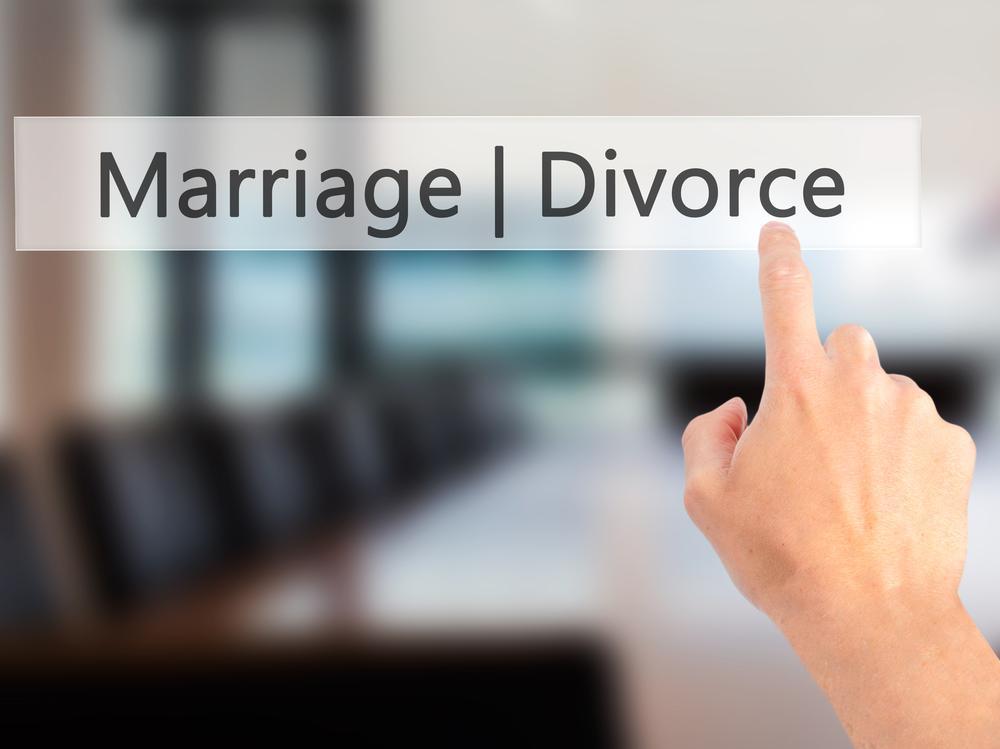 Hand pointing to word divorce
